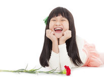 Happy little girl with carnation flower Stock Image