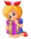 Happy little girl cartoon holding birthday gift box Royalty Free Stock Photography