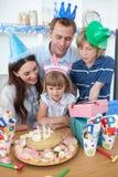 Happy little girl celebrating her birthday Stock Photos