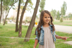 Happy little girl is celebrating her birthday Stock Images
