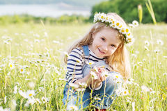 Happy little girl in the chamomile field Royalty Free Stock Images