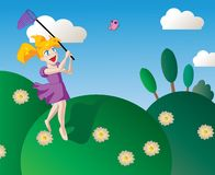 Happy little girl chasing butterflies Royalty Free Stock Photos