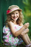 Happy little girl cheerfully laughs Stock Image