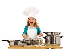 Happy little girl with chef hat making noise