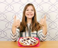 Little girl with cherry pie and thumbs up Royalty Free Stock Images