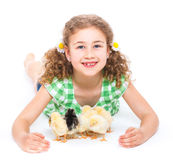 Happy little girl with chickens Royalty Free Stock Image