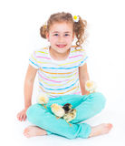 Happy little girl with chickens Stock Photography
