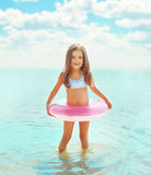 Happy little girl child bathing with inflatable circle Stock Photos