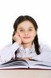 Happy little girl child with a book on a white background Royalty Free Stock Photo