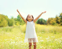 Happy little girl child enjoying sunny summer day and having fun Stock Photos