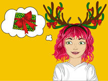 Happy little girl with Christmas deer horns on his head. Stock Photography