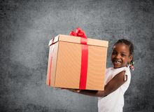 Happy little girl with a Christmas gift stock image