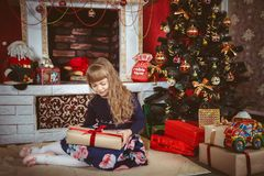 Happy little girl with christmas gift box Royalty Free Stock Photos