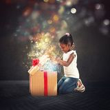 Happy little girl with a Christmas gift royalty free stock photo