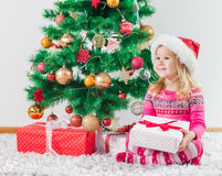 Happy Little Girl with Christmas Gift Stock Photos