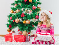 Happy Little Girl with Christmas Gift Royalty Free Stock Image