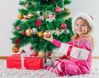Happy Little Girl with Christmas Gift Royalty Free Stock Photo