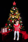 Happy little girl with Christmas gifts Royalty Free Stock Images