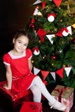 Happy little girl with Christmas gifts Royalty Free Stock Photos