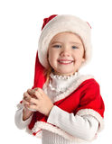 Happy little girl with christmas hat Royalty Free Stock Photography
