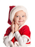 Happy little girl with christmas hat Stock Images