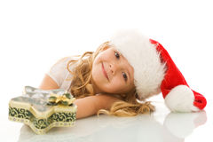 Happy little girl with christmas present Stock Photos