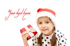 Happy little girl with christmas present Stock Image
