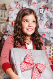 Happy little girl at Christmas Stock Photo