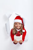 Happy little girl with christmas present Royalty Free Stock Photos