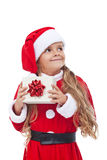 Happy little girl with christmas present Royalty Free Stock Photography