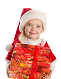 Happy little girl with christmas present smiling Stock Photos