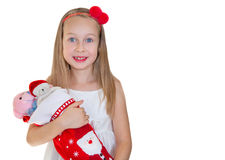 Happy little girl with Christmas presents Stock Images