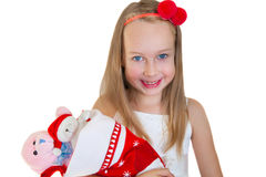 Happy little girl with Christmas presents Royalty Free Stock Photography