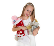 Happy little girl with Christmas presents Stock Photo