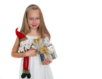 Happy little girl with Christmas presents Royalty Free Stock Images