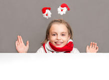 Happy little girl in the Christmas the symbols on the background Royalty Free Stock Photo