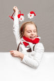 Happy little girl in the Christmas the symbols on the background Royalty Free Stock Image