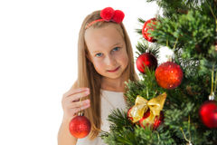 Happy little girl with Christmas tree Stock Photo