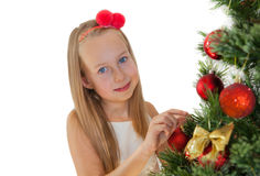 Happy little girl with Christmas tree Stock Image