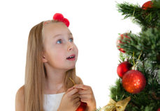Happy little girl with Christmas tree Royalty Free Stock Image