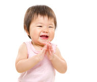 Happy little girl clapping Royalty Free Stock Images