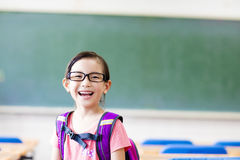 Happy little girl in the classroom Stock Photos