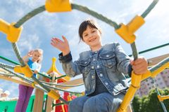 Happy little girl climbing on children playground Royalty Free Stock Photography