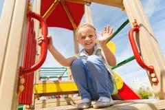 Happy little girl climbing on children playground Stock Image