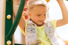 Happy little girl climbing on children playground Stock Photography