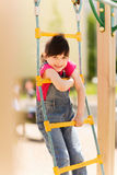 Happy little girl climbing on children playground Royalty Free Stock Image
