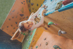 Happy little girl climbing indoor stock images