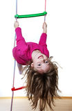 Happy little girl climbing on a ladder Stock Photo