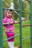 Happy little girl climbing on outdoor playground Royalty Free Stock Photos