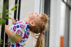 Happy little girl climbing Stock Photography